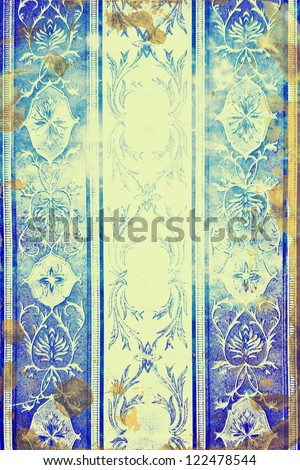 Abstract textured background: blue, brown, and white floral patterns on yellow backdrop. For art texture, grunge design, and vintage paper / border frame - stock photo