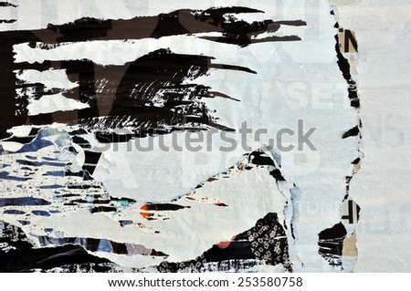 Abstract torn posters grungy paper background texture.