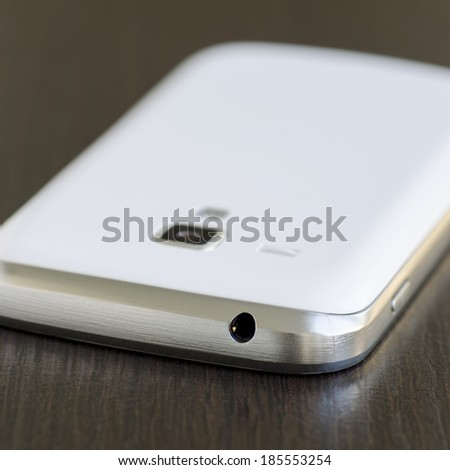 Abstract touchscreen smartphone - face down