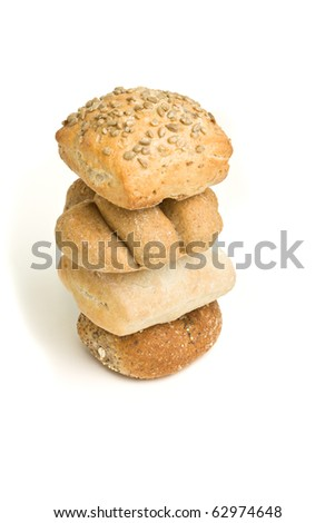 Abstract tower of handmade bread rolls from low perspective isolated against white.