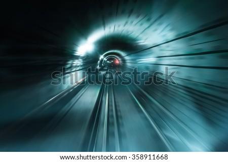 Abstract traffic background. Dark underground tunnel with blurred light tracks. Motion blur - stock photo