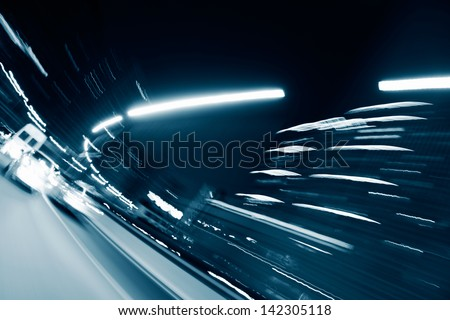 Abstract traffic lights in motion blur at night. - stock photo
