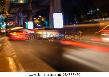 abstract traffic night light background with blurry shallow depth of focus. - stock photo