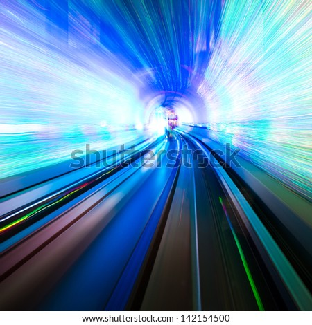 Abstract train moving in tunnel. - stock photo