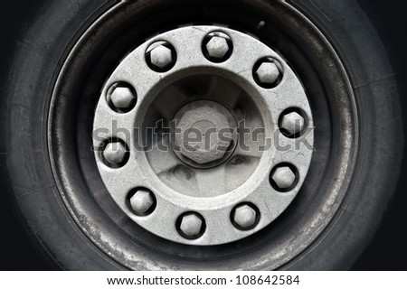 Abstract transportation background. Closeup photo texture of cargo truck wheel