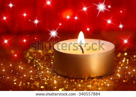 abstract  twinkled  christmas background with a candle - stock photo