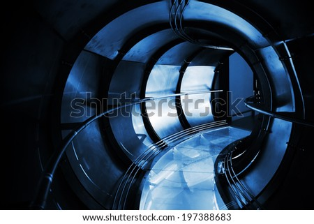 Abstract underground industrial sewerage. Dark blue metal tunnel interior