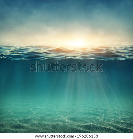 Abstract underwater background with sunbeams - stock photo