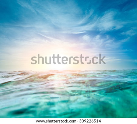 Abstract underwater background with sunbeams. - stock photo