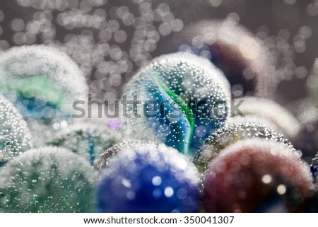 Abstract underwater composition with colorful glass balls, bubbles and light