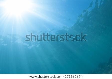 Abstract underwater scene, sun rays. - stock photo