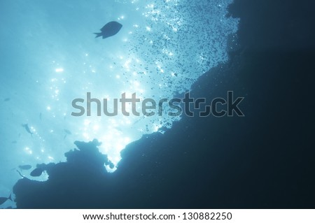 abstract underwater scene sunrays  in deep blue sea - stock photo