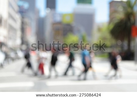 Abstract urban background with blurred buildings, street and pedestrians - stock photo