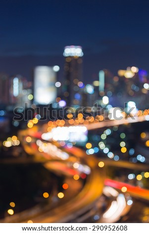 Abstract urban intersection road light bokeh , defocused background - stock photo