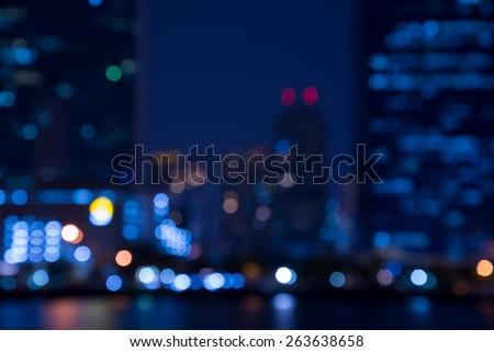 Abstract urban night light bokeh before rain, defocused background - stock photo