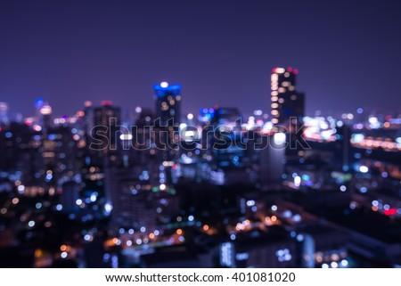 Abstract urban night light bokeh defocused background - stock photo