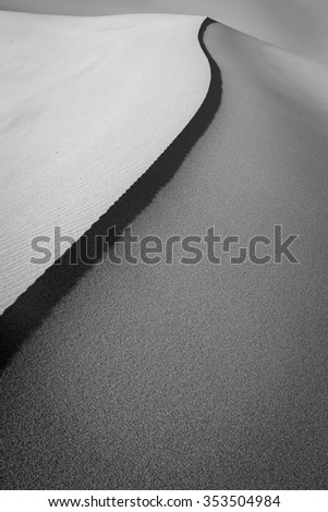 Abstract vertical sand dune image. - stock photo