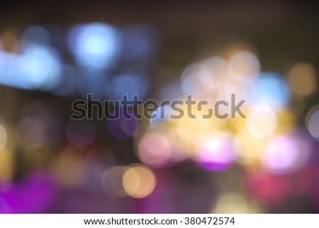 Abstract vibrant bright round bokeh over dark background - stock photo