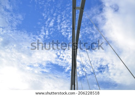 Abstract view of bridge support on cloudy  sky. - stock photo
