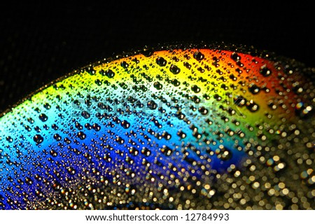 Abstract view of CD covered with water drops