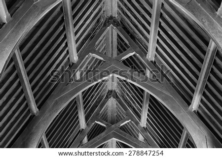 Abstract view of timber rafter beams of an old church building - stock photo