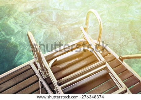 Abstract view of yacht stairs and sea water - stock photo