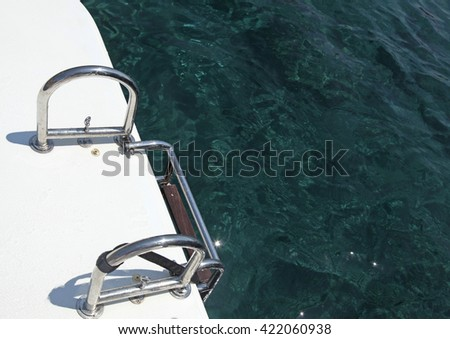 Abstract view of yacht stairs and turquoise sea - stock photo