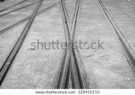 Abstract view. Transportation background with railway crossing on gray asphalt. Soft selective focus and shallow depth of field - stock photo