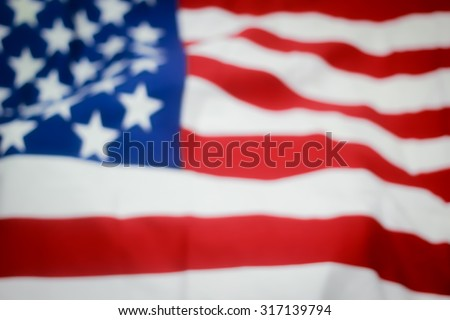 abstract vintage blurred crumpled retro american flag with vignette backgrounds:blur creased fabric of American flag with backgrounds.independence day.patriotic concept.citizenship day.veteran day - stock photo