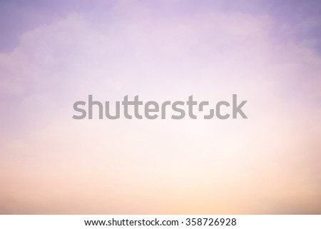 abstract vintage soft cloud and pastel tone color sky backdrop:blurry night dusk focus:blur color sunset/morning background with shine lens flare light:blurry orange and purple concept.sweet wallpaper - stock photo