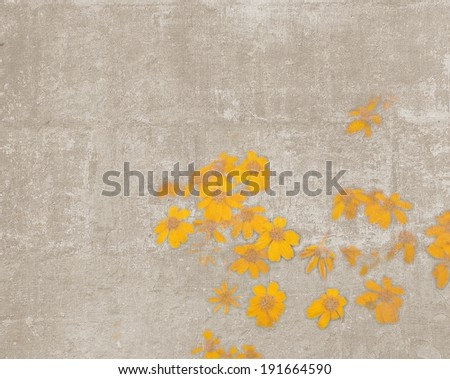 Abstract vintage textured background with disorderly small yellow wild flowers - stock photo