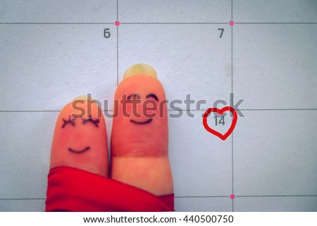 Abstract vintage tone of finger writing face of man and woman holding together smiling on calendar and marking on number 14 with love sign, valentine concept.  - stock photo