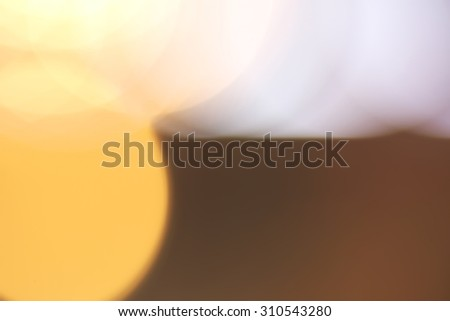 Abstract vivid orange and white bokeh background - stock photo