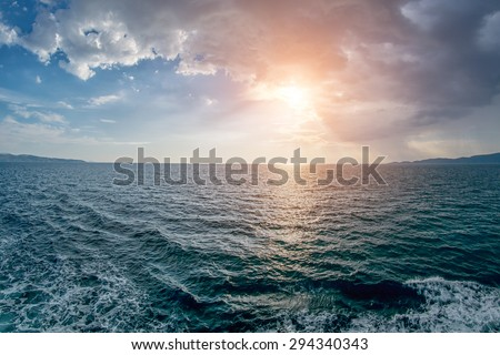 Abstract Warm Sunset at Sea with Waves, Clouds and Foam