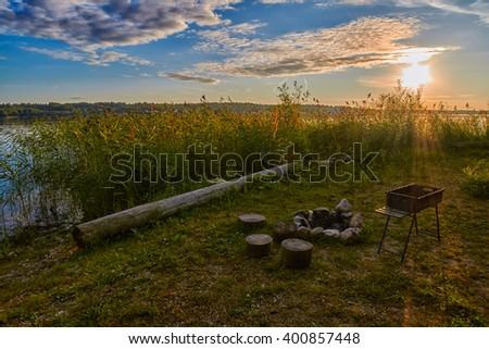 Abstract warm Sunset Lake Camping Fireplace Picnic - stock photo