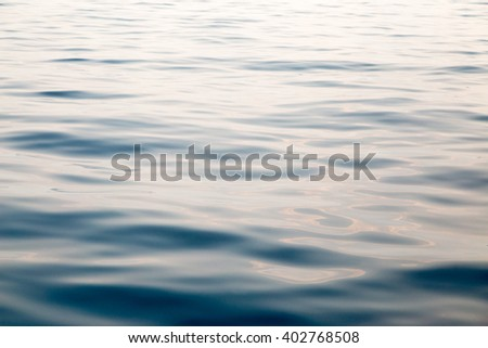 Abstract water background with smooth wave - stock photo