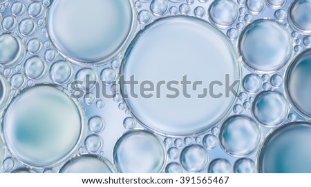 Abstract water bubbles light illumination background, art of water bubbles on water surface background display for your products and artwork design. Abstract glare on bubbles and watery background.