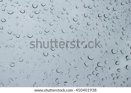 abstract water drop on blue mirror in black and white : for background use