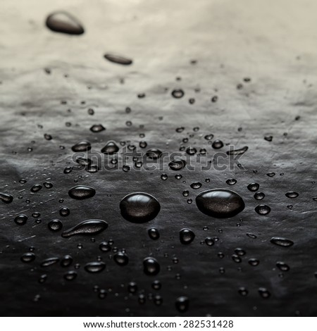 Abstract water drops art. Bubbles black background. Toned photo. macro view, soft focus. - stock photo