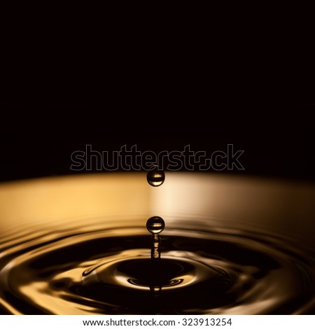Abstract water object. Conceptual image of falling water drop and pause. Darkness and light conception. splashing. Black background. closeup, soft focus, shallow depth of field. copy space - stock photo