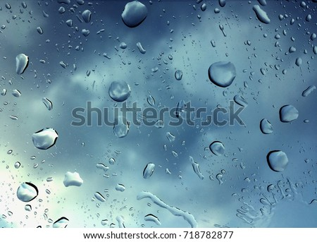 Abstract Water rain drops on window glass surface Background