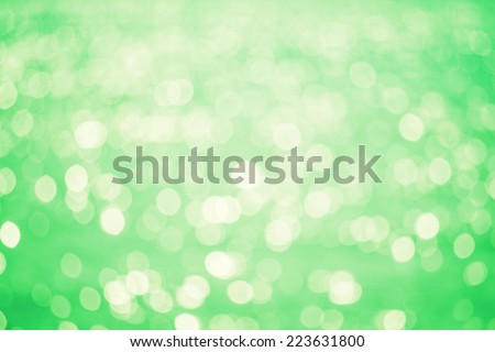 Abstract Water reflect light bokeh background. Green filter. - stock photo