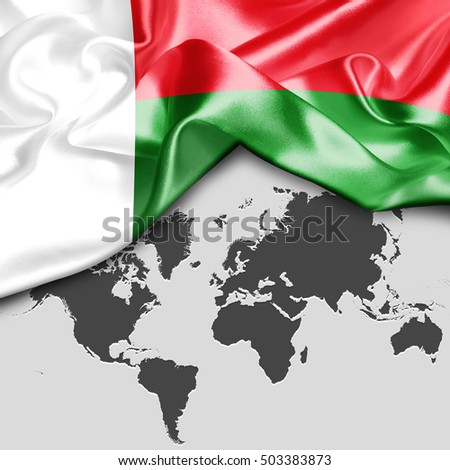 Abstract waving Madgascar flag over world map