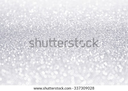 Abstract white and silver glitter sparkle background. Frosty winter confetti party invitation - stock photo