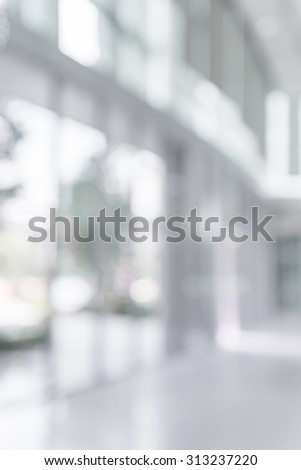 Abstract white blur background from building hallway corridor - stock photo