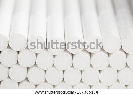 abstract white filters of cigarettes, closeup view