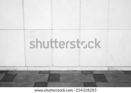 Abstract white urban background interior with tiling on the wall and road pavement