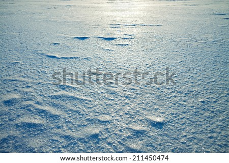 abstract winter background from snow shiny in the sun - stock photo