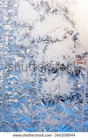 abstract winter texture with frost pattern on frozen window - stock photo