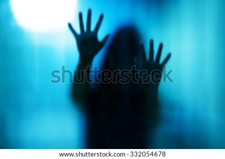 Abstract woman behind the matte glass. Blurry hand and body figure  - stock photo